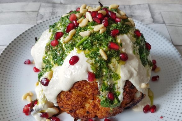 Whole Roasted Harissa Cauliflower With Herbs And Tahini Yogurt